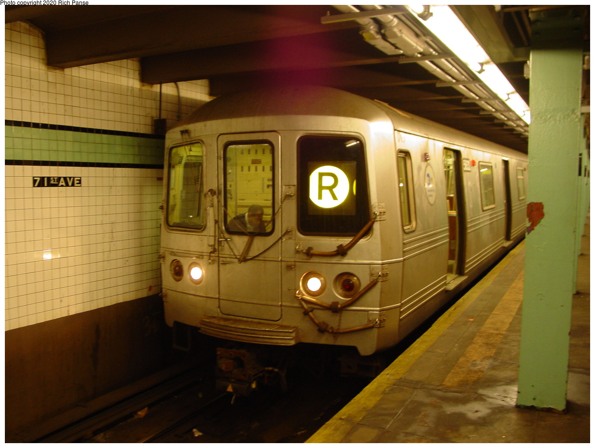 (69k, 820x620)<br><b>Country:</b> United States<br><b>City:</b> New York<br><b>System:</b> New York City Transit<br><b>Line:</b> IND Queens Boulevard Line<br><b>Location:</b> 71st/Continental Aves./Forest Hills <br><b>Route:</b> R<br><b>Car:</b> R-46 (Pullman-Standard, 1974-75)  <br><b>Photo by:</b> Richard Panse<br><b>Date:</b> 2/4/2004<br><b>Viewed (this week/total):</b> 0 / 11104