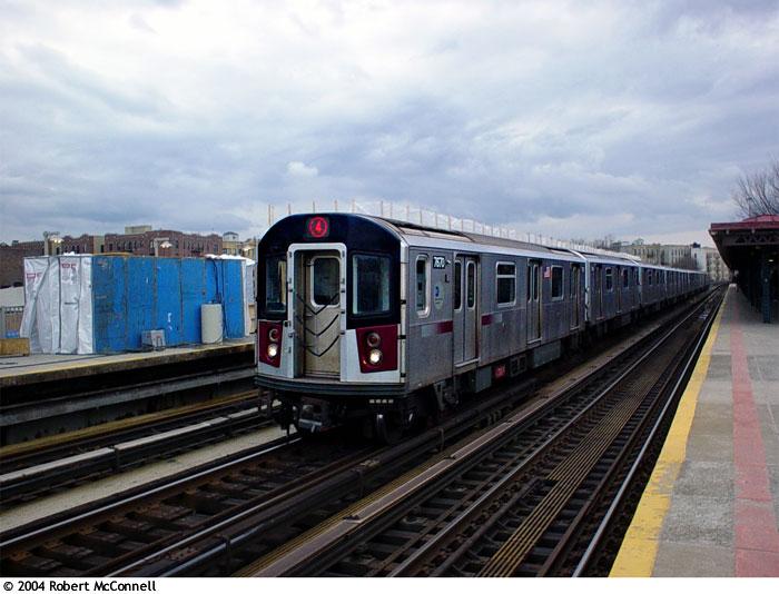 (83k, 700x534)<br><b>Country:</b> United States<br><b>City:</b> New York<br><b>System:</b> New York City Transit<br><b>Line:</b> IRT Woodlawn Line<br><b>Location:</b> Bedford Park Boulevard <br><b>Route:</b> 4<br><b>Car:</b> R-142A (Option Order, Kawasaki, 2002-2003)  7670 <br><b>Photo by:</b> Robert McConnell<br><b>Date:</b> 4/4/2004<br><b>Viewed (this week/total):</b> 0 / 4549