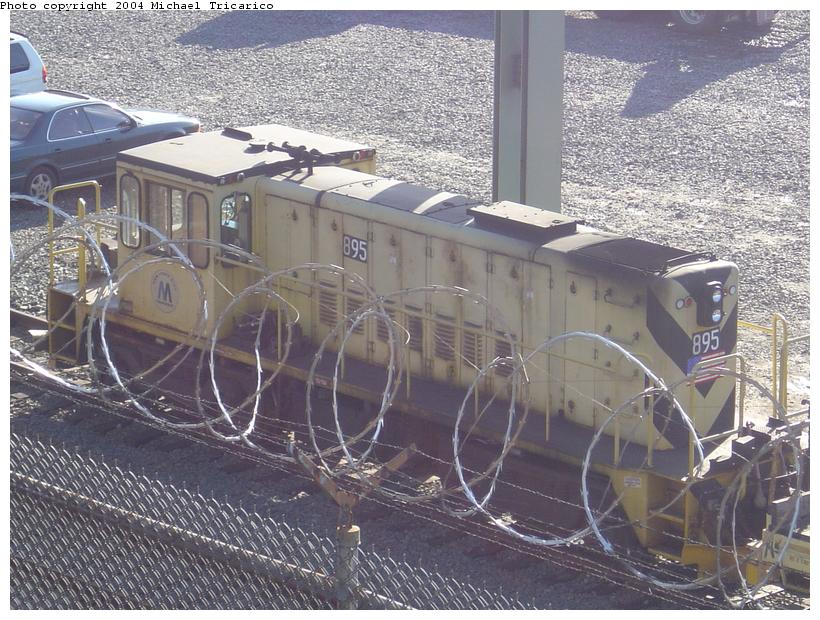 (120k, 820x620)<br><b>Country:</b> United States<br><b>City:</b> New York<br><b>System:</b> New York City Transit<br><b>Location:</b> 207th Street Yard<br><b>Car:</b> R-77 Locomotive  895 <br><b>Photo by:</b> Michael Tricarico<br><b>Date:</b> 4/16/2004<br><b>Viewed (this week/total):</b> 1 / 1979