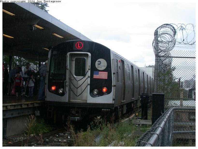 (106k, 820x620)<br><b>Country:</b> United States<br><b>City:</b> New York<br><b>System:</b> New York City Transit<br><b>Line:</b> BMT Canarsie Line<br><b>Location:</b> Rockaway Parkway <br><b>Route:</b> M<br><b>Car:</b> R-143 (Kawasaki, 2001-2002) 8136 <br><b>Photo by:</b> Joe Testagrose<br><b>Date:</b> 9/27/2003<br><b>Viewed (this week/total):</b> 2 / 3774