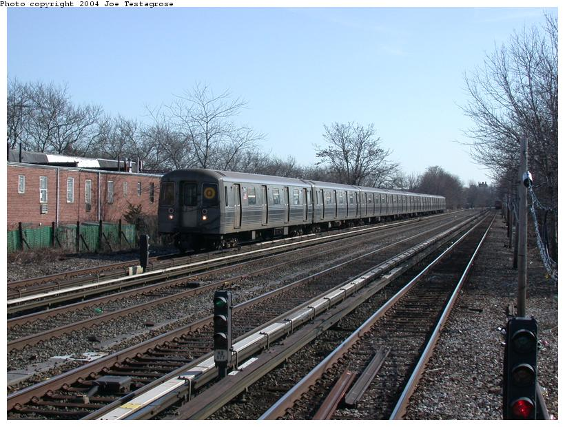 (140k, 820x620)<br><b>Country:</b> United States<br><b>City:</b> New York<br><b>System:</b> New York City Transit<br><b>Line:</b> BMT Brighton Line<br><b>Location:</b> Neck Road <br><b>Route:</b> Q<br><b>Car:</b> R-68 (Westinghouse-Amrail, 1986-1988)  2886 <br><b>Photo by:</b> Joe Testagrose<br><b>Date:</b> 2/28/2004<br><b>Viewed (this week/total):</b> 2 / 3139