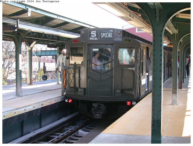 (124k, 820x620)<br><b>Country:</b> United States<br><b>City:</b> New York<br><b>System:</b> New York City Transit<br><b>Line:</b> BMT Nassau Street/Jamaica Line<br><b>Location:</b> Broadway/East New York (Broadway Junction) <br><b>Route:</b> Fan Trip<br><b>Car:</b> R-1 (American Car & Foundry, 1930-1931) 100 <br><b>Photo by:</b> Joe Testagrose<br><b>Date:</b> 11/9/2003<br><b>Viewed (this week/total):</b> 0 / 3621