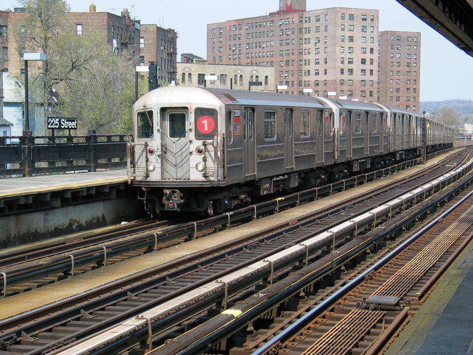 (162k, 950x713)<br><b>Country:</b> United States<br><b>City:</b> New York<br><b>System:</b> New York City Transit<br><b>Line:</b> IRT West Side Line<br><b>Location:</b> 225th Street <br><b>Route:</b> 1<br><b>Car:</b> R-62A (Bombardier, 1984-1987)  2230 <br><b>Photo by:</b> David of Broadway<br><b>Date:</b> 4/18/2004<br><b>Viewed (this week/total):</b> 0 / 4031