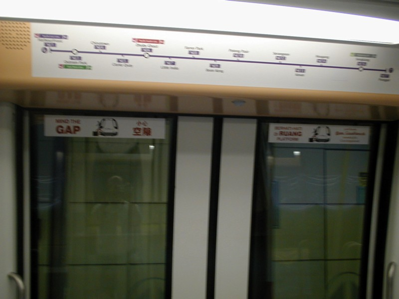 (71k, 800x600)<br><b>Country:</b> Singapore<br><b>City:</b> Singapore<br><b>System:</b> Singapore MRT<br><b>Line:</b> North-South Line <br><b>Photo by:</b> Todd Glickman<br><b>Date:</b> 11/15/2003<br><b>Notes:</b> North-East line strip maps are above each door (four per side); note the Mind the Gap signs in four languages.<br><b>Viewed (this week/total):</b> 1 / 2725