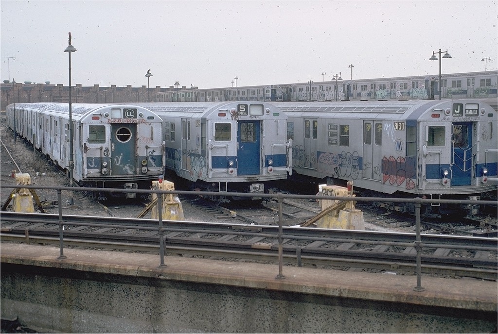 (219k, 1024x688)<br><b>Country:</b> United States<br><b>City:</b> New York<br><b>System:</b> New York City Transit<br><b>Location:</b> East New York Yard/Shops<br><b>Car:</b> R-16 (American Car & Foundry, 1955) 6413 <br><b>Photo by:</b> Doug Grotjahn<br><b>Collection of:</b> Joe Testagrose<br><b>Date:</b> 12/7/1980<br><b>Notes:</b> with R27/30 8456-8130<br><b>Viewed (this week/total):</b> 1 / 7063