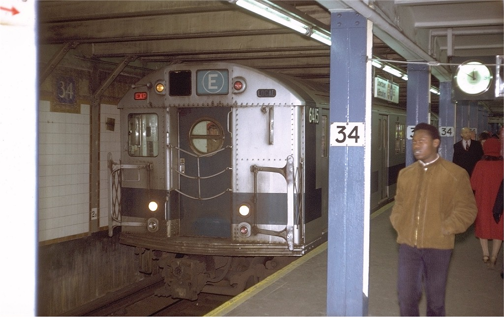 (169k, 1024x645)<br><b>Country:</b> United States<br><b>City:</b> New York<br><b>System:</b> New York City Transit<br><b>Line:</b> BMT Broadway Line<br><b>Location:</b> 34th Street/Herald Square <br><b>Route:</b> E<br><b>Car:</b> R-16 (American Car & Foundry, 1955) 6415 <br><b>Photo by:</b> Steve Zabel<br><b>Collection of:</b> Joe Testagrose<br><b>Date:</b> 12/4/1971<br><b>Viewed (this week/total):</b> 4 / 5976