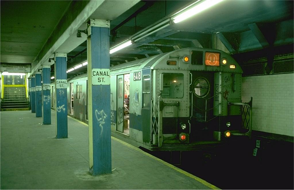 (165k, 1024x660)<br><b>Country:</b> United States<br><b>City:</b> New York<br><b>System:</b> New York City Transit<br><b>Line:</b> BMT Nassau Street/Jamaica Line<br><b>Location:</b> Canal Street <br><b>Route:</b> JJ<br><b>Car:</b> R-16 (American Car & Foundry, 1955) 6418 (ex-6400)<br><b>Photo by:</b> Doug Grotjahn<br><b>Collection of:</b> Joe Testagrose<br><b>Date:</b> 12/30/1976<br><b>Viewed (this week/total):</b> 1 / 6725