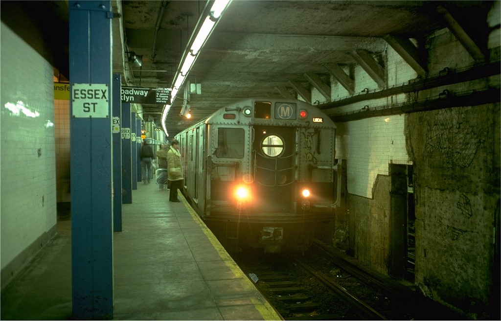 (163k, 1024x656)<br><b>Country:</b> United States<br><b>City:</b> New York<br><b>System:</b> New York City Transit<br><b>Line:</b> BMT Nassau Street/Jamaica Line<br><b>Location:</b> Essex Street <br><b>Route:</b> M<br><b>Car:</b> R-16 (American Car & Foundry, 1955) 6497 <br><b>Photo by:</b> Doug Grotjahn<br><b>Collection of:</b> Joe Testagrose<br><b>Date:</b> 1/3/1977<br><b>Viewed (this week/total):</b> 1 / 7164