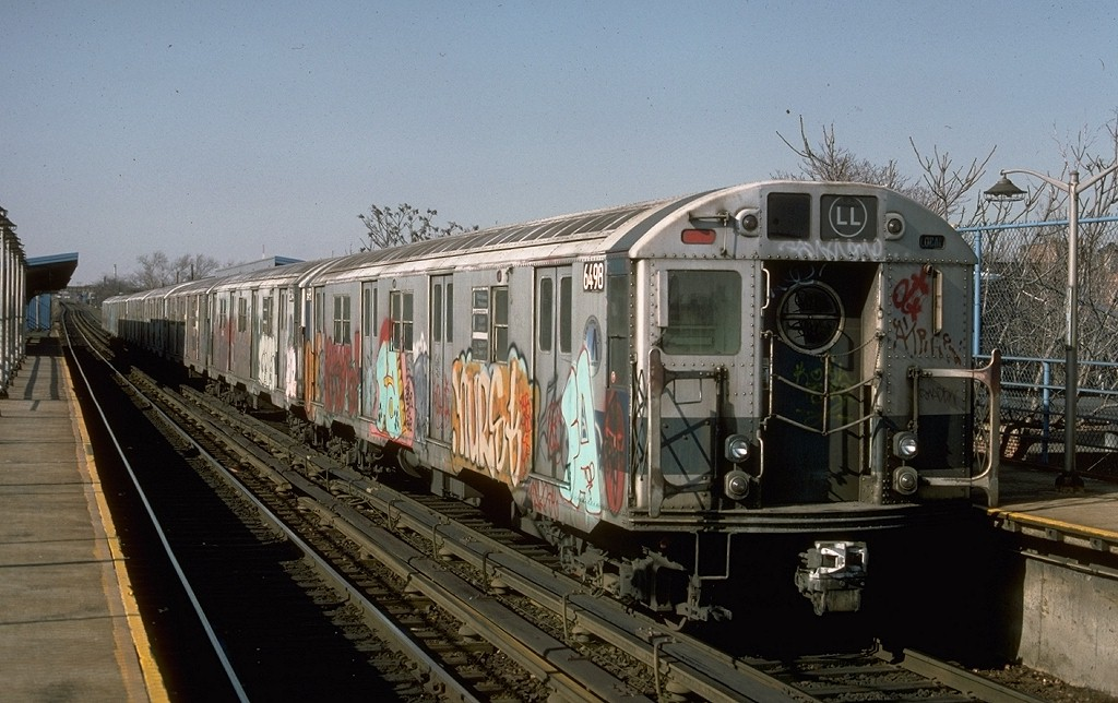 (193k, 1024x644)<br><b>Country:</b> United States<br><b>City:</b> New York<br><b>System:</b> New York City Transit<br><b>Line:</b> BMT Canarsie Line<br><b>Location:</b> New Lots Avenue <br><b>Route:</b> LL<br><b>Car:</b> R-16 (American Car & Foundry, 1955) 6498 <br><b>Photo by:</b> Ed McKernan<br><b>Collection of:</b> Joe Testagrose<br><b>Date:</b> 3/21/1977<br><b>Viewed (this week/total):</b> 0 / 5958