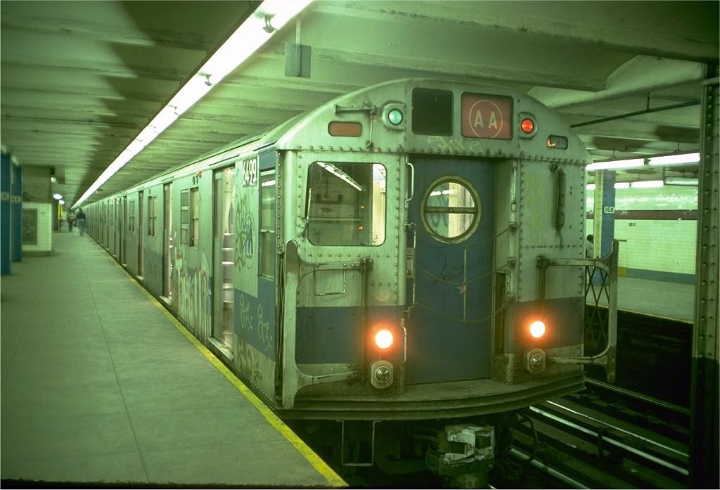 (174k, 1024x697)<br><b>Country:</b> United States<br><b>City:</b> New York<br><b>System:</b> New York City Transit<br><b>Line:</b> IND 8th Avenue Line<br><b>Location:</b> 168th Street <br><b>Route:</b> AA<br><b>Car:</b> R-16 (American Car & Foundry, 1955) 6499 <br><b>Photo by:</b> Doug Grotjahn<br><b>Collection of:</b> Joe Testagrose<br><b>Date:</b> 12/9/1976<br><b>Viewed (this week/total):</b> 4 / 6631