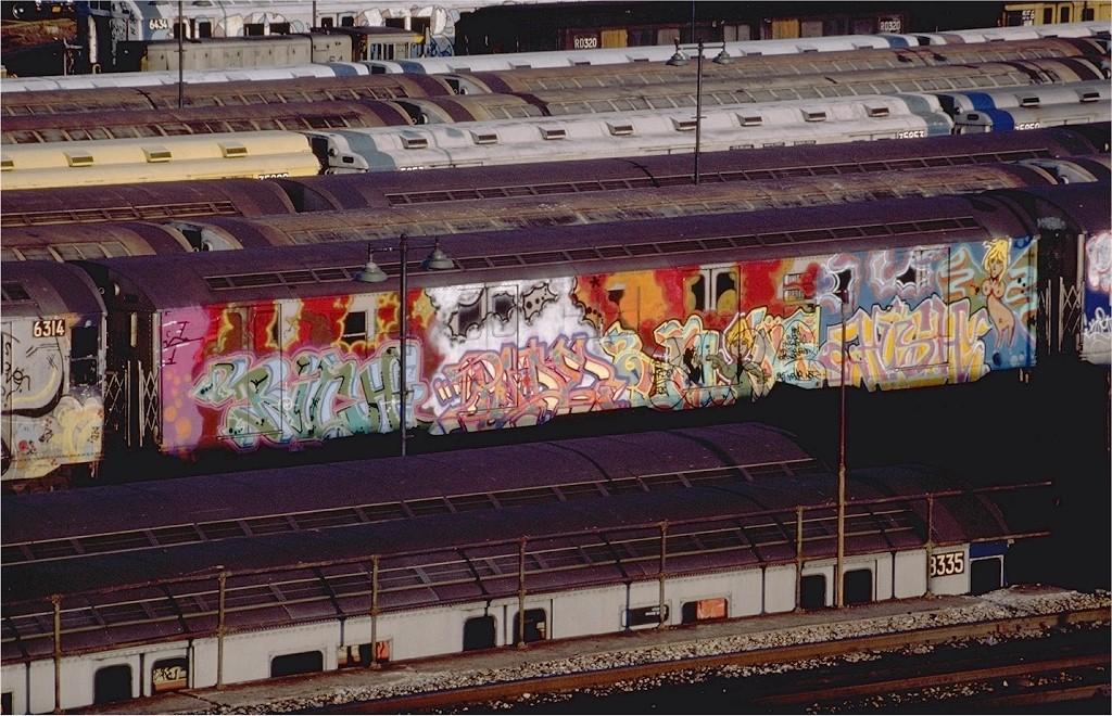 (245k, 1024x660)<br><b>Country:</b> United States<br><b>City:</b> New York<br><b>System:</b> New York City Transit<br><b>Location:</b> East New York Yard/Shops<br><b>Car:</b> R-16 (American Car & Foundry, 1955)  <br><b>Photo by:</b> Steve Zabel<br><b>Collection of:</b> Joe Testagrose<br><b>Date:</b> 12/9/1982<br><b>Viewed (this week/total):</b> 1 / 10567