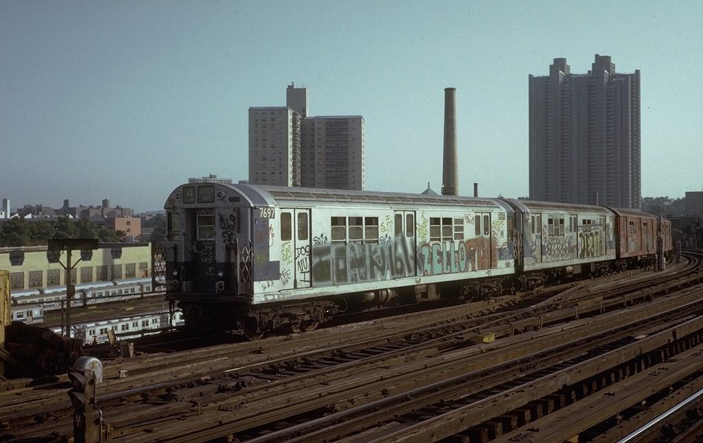 (177k, 1024x646)<br><b>Country:</b> United States<br><b>City:</b> New York<br><b>System:</b> New York City Transit<br><b>Line:</b> IRT Woodlawn Line<br><b>Location:</b> Bedford Park Boulevard <br><b>Route:</b> 4<br><b>Car:</b> R-22 (St. Louis, 1957-58) 7697 <br><b>Photo by:</b> Steve Zabel<br><b>Collection of:</b> Joe Testagrose<br><b>Date:</b> 7/19/1973<br><b>Viewed (this week/total):</b> 0 / 4551