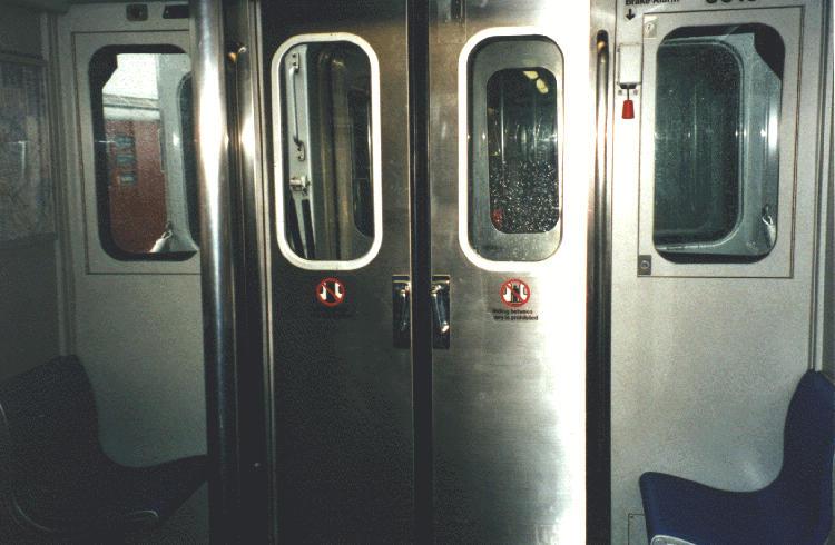 (61k, 750x490)<br><b>Country:</b> United States<br><b>City:</b> New York<br><b>System:</b> New York City Transit<br><b>Car:</b> R-110A (Kawasaki, 1992) Interior <br><b>Photo by:</b> Steve Kreisler<br><b>Date:</b> 1997<br><b>Notes:</b> Interior end door<br><b>Viewed (this week/total):</b> 1 / 7798