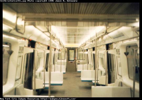 (38k, 540x379)<br><b>Country:</b> United States<br><b>City:</b> New York<br><b>System:</b> New York City Transit<br><b>Car:</b> R-110B (Bombardier, 1992) Interior <br><b>Photo by:</b> Jason R. DeCesare<br><b>Date:</b> 1997<br><b>Notes:</b> Interior, white color scheme<br><b>Viewed (this week/total):</b> 12 / 26131
