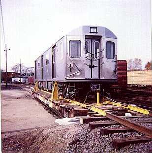 (18k, 309x311)<br><b>Country:</b> United States<br><b>City:</b> New York<br><b>System:</b> New York City Transit<br><b>Location:</b> LIRR/NY & Atlantic RR Fresh Pond Yard <br><b>Car:</b> R-142 or R-142A (Number Unknown)  <br><b>Photo by:</b> Bernard Ente<br><b>Date:</b> 11/1999<br><b>Notes:</b> First delivery of Bombardier R142 cars.<br><b>Viewed (this week/total):</b> 7 / 10482