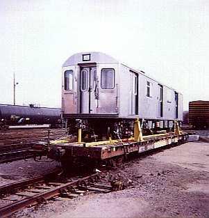 (15k, 301x313)<br><b>Country:</b> United States<br><b>City:</b> New York<br><b>System:</b> New York City Transit<br><b>Location:</b> LIRR/NY & Atlantic RR Fresh Pond Yard <br><b>Car:</b> R-142 or R-142A (Number Unknown)  <br><b>Photo by:</b> Bernard Ente<br><b>Date:</b> 11/1999<br><b>Notes:</b> First delivery of Bombardier R142 cars.<br><b>Viewed (this week/total):</b> 5 / 8113