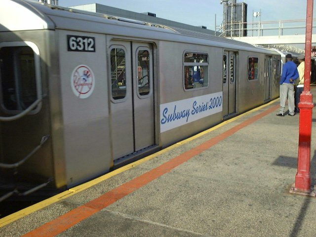 (77k, 640x480)<br><b>Country:</b> United States<br><b>City:</b> New York<br><b>System:</b> New York City Transit<br><b>Line:</b> IRT White Plains Road Line<br><b>Location:</b> East 180th Street <br><b>Car:</b> R-142 (Primary Order, Bombardier, 1999-2002)  6312 <br><b>Photo by:</b> Trevor Logan<br><b>Date:</b> 10/21/2000<br><b>Notes:</b> World Series Special<br><b>Viewed (this week/total):</b> 0 / 6293