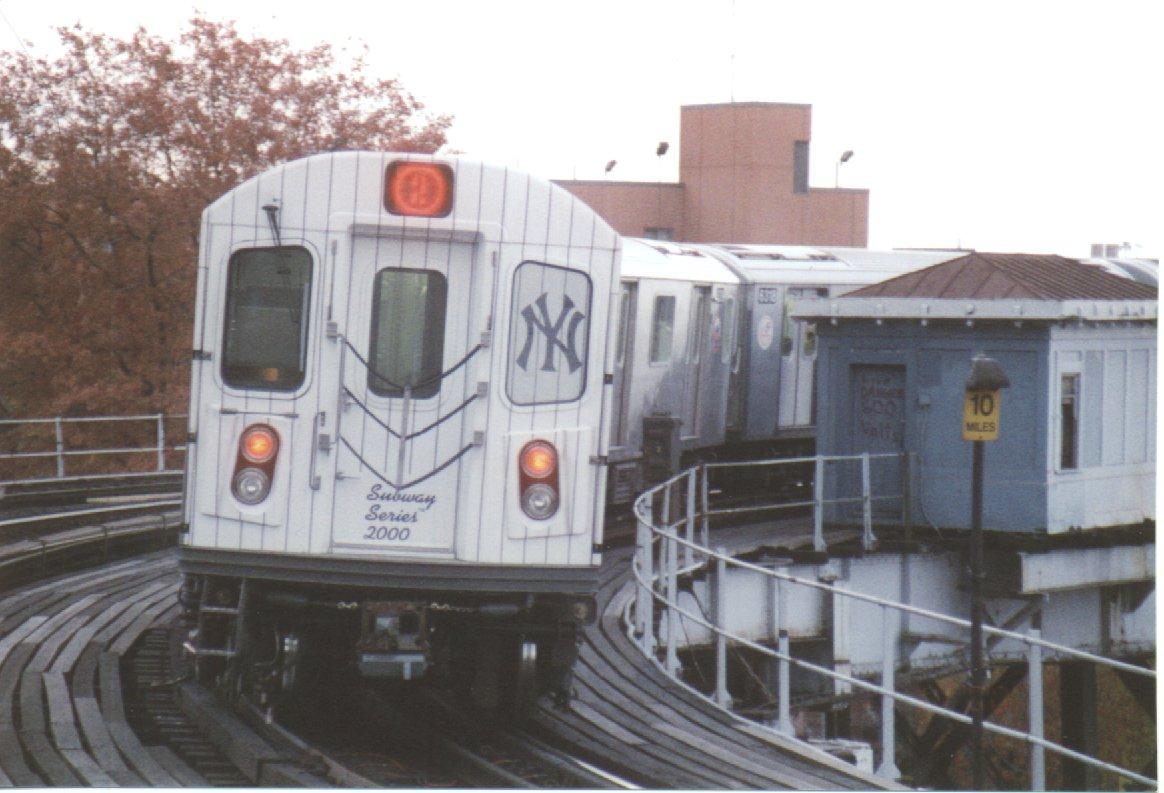 (137k, 1164x793)<br><b>Country:</b> United States<br><b>City:</b> New York<br><b>System:</b> New York City Transit<br><b>Line:</b> IRT White Plains Road Line<br><b>Location:</b> West Farms Sq./East Tremont Ave./177th St. <br><b>Route:</b> 2<br><b>Car:</b> R-142 (Primary Order, Bombardier, 1999-2002)  6320 <br><b>Photo by:</b> Khalis Ward<br><b>Date:</b> 2000<br><b>Viewed (this week/total):</b> 0 / 7668