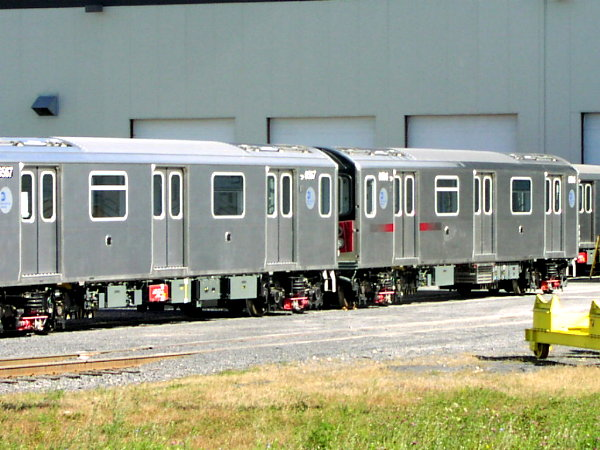(79k, 600x450)<br><b>Country:</b> United States<br><b>City:</b> New York<br><b>System:</b> New York City Transit<br><b>Location:</b> Bombardier Plant, Plattsburgh, NY<br><b>Car:</b> R-142 (Primary Order, Bombardier, 1999-2002)  6567 <br><b>Photo by:</b> Trevor Logan<br><b>Date:</b> 10/9/2001<br><b>Notes:</b> With R142 6801<br><b>Viewed (this week/total):</b> 0 / 5143