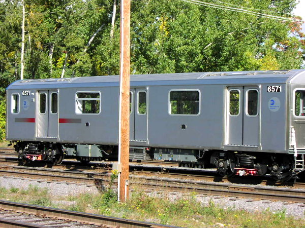 (124k, 600x450)<br><b>Country:</b> United States<br><b>City:</b> New York<br><b>System:</b> New York City Transit<br><b>Location:</b> Bombardier Plant, Plattsburgh, NY<br><b>Car:</b> R-142 (Primary Order, Bombardier, 1999-2002)  6571 <br><b>Photo by:</b> Trevor Logan<br><b>Date:</b> 10/9/2001<br><b>Viewed (this week/total):</b> 1 / 4118