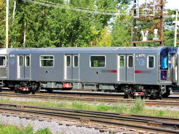 (128k, 600x450)<br><b>Country:</b> United States<br><b>City:</b> New York<br><b>System:</b> New York City Transit<br><b>Location:</b> Bombardier Plant, Plattsburgh, NY<br><b>Car:</b> R-142 (Primary Order, Bombardier, 1999-2002)  6575 <br><b>Photo by:</b> Trevor Logan<br><b>Date:</b> 10/9/2001<br><b>Viewed (this week/total):</b> 0 / 4781