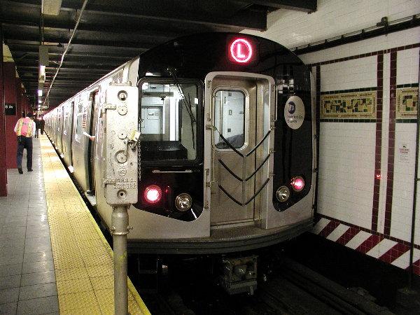 (88k, 600x450)<br><b>Country:</b> United States<br><b>City:</b> New York<br><b>System:</b> New York City Transit<br><b>Line:</b> BMT Canarsie Line<br><b>Location:</b> 8th Avenue <br><b>Route:</b> L<br><b>Car:</b> R-143 (Kawasaki, 2001-2002) 8101 <br><b>Photo by:</b> Trevor Logan<br><b>Date:</b> 12/4/2001<br><b>Viewed (this week/total):</b> 2 / 20290