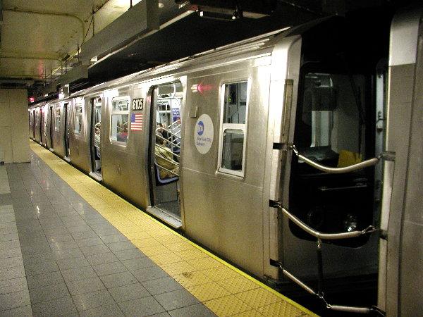 (82k, 600x450)<br><b>Country:</b> United States<br><b>City:</b> New York<br><b>System:</b> New York City Transit<br><b>Line:</b> BMT Canarsie Line<br><b>Location:</b> 8th Avenue <br><b>Route:</b> L<br><b>Car:</b> R-143 (Kawasaki, 2001-2002) 8105 <br><b>Photo by:</b> Trevor Logan<br><b>Date:</b> 12/4/2001<br><b>Viewed (this week/total):</b> 4 / 7214