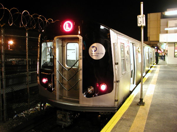 (75k, 600x450)<br><b>Country:</b> United States<br><b>City:</b> New York<br><b>System:</b> New York City Transit<br><b>Line:</b> BMT Canarsie Line<br><b>Location:</b> Rockaway Parkway <br><b>Route:</b> L<br><b>Car:</b> R-143 (Kawasaki, 2001-2002) 8101 <br><b>Photo by:</b> Trevor Logan<br><b>Date:</b> 12/4/2001<br><b>Viewed (this week/total):</b> 0 / 5200