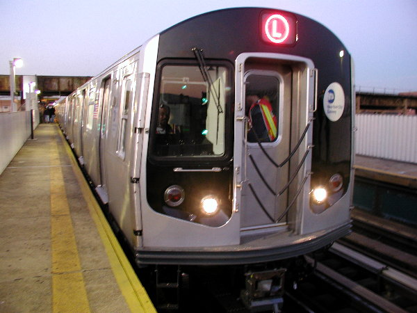 (65k, 600x450)<br><b>Country:</b> United States<br><b>City:</b> New York<br><b>System:</b> New York City Transit<br><b>Line:</b> BMT Canarsie Line<br><b>Location:</b> Livonia Avenue <br><b>Route:</b> L<br><b>Car:</b> R-143 (Kawasaki, 2001-2002) 8108 <br><b>Photo by:</b> Trevor Logan<br><b>Date:</b> 12/4/2001<br><b>Viewed (this week/total):</b> 5 / 4943