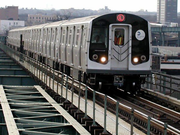 (87k, 600x450)<br><b>Country:</b> United States<br><b>City:</b> New York<br><b>System:</b> New York City Transit<br><b>Line:</b> BMT Canarsie Line<br><b>Location:</b> Atlantic Avenue <br><b>Route:</b> L<br><b>Car:</b> R-143 (Kawasaki, 2001-2002) 8101 <br><b>Photo by:</b> Trevor Logan<br><b>Date:</b> 12/6/2001<br><b>Viewed (this week/total):</b> 1 / 5904