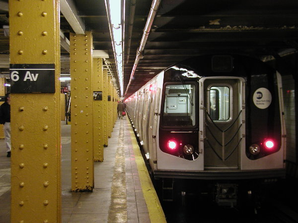 (68k, 600x450)<br><b>Country:</b> United States<br><b>City:</b> New York<br><b>System:</b> New York City Transit<br><b>Line:</b> BMT Canarsie Line<br><b>Location:</b> 6th Avenue <br><b>Route:</b> L<br><b>Car:</b> R-143 (Kawasaki, 2001-2002) 8108 <br><b>Photo by:</b> Trevor Logan<br><b>Date:</b> 12/6/2001<br><b>Viewed (this week/total):</b> 2 / 6094