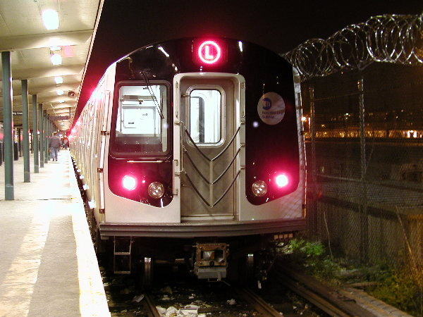 (81k, 600x450)<br><b>Country:</b> United States<br><b>City:</b> New York<br><b>System:</b> New York City Transit<br><b>Line:</b> BMT Canarsie Line<br><b>Location:</b> Rockaway Parkway <br><b>Route:</b> L<br><b>Car:</b> R-143 (Kawasaki, 2001-2002) 8108 <br><b>Photo by:</b> Trevor Logan<br><b>Date:</b> 12/6/2001<br><b>Viewed (this week/total):</b> 0 / 5349