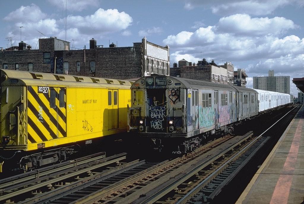 (244k, 1024x686)<br><b>Country:</b> United States<br><b>City:</b> New York<br><b>System:</b> New York City Transit<br><b>Line:</b> IRT Pelham Line<br><b>Location:</b> Elder Avenue <br><b>Route:</b> 6<br><b>Car:</b> R-29 (St. Louis, 1962) 8594 <br><b>Photo by:</b> Steve Zabel<br><b>Collection of:</b> Joe Testagrose<br><b>Date:</b> 10/16/1982<br><b>Notes:</b> With RD327<br><b>Viewed (this week/total):</b> 10 / 6135