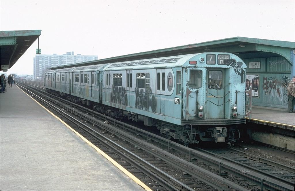 (183k, 1024x664)<br><b>Country:</b> United States<br><b>City:</b> New York<br><b>System:</b> New York City Transit<br><b>Line:</b> IND Rockaway<br><b>Location:</b> Beach 90th Street/Holland <br><b>Route:</b> Fan Trip<br><b>Car:</b> R-33 World's Fair (St. Louis, 1963-64) 9327 <br><b>Photo by:</b> Doug Grotjahn<br><b>Collection of:</b> Joe Testagrose<br><b>Date:</b> 11/27/1976<br><b>Viewed (this week/total):</b> 5 / 4341