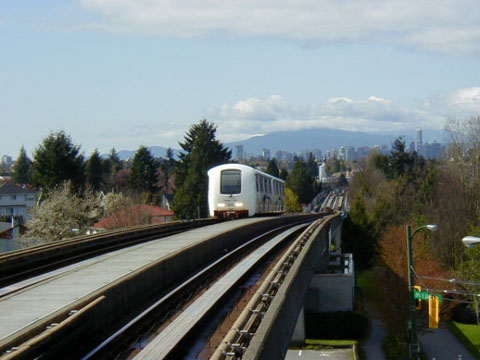 (52k, 480x360)<br><b>Country:</b> Canada<br><b>City:</b> Vancouver<br><b>System:</b> SkyTrain<br><b>Line:</b> Expo Line<br><b>Location:</b> Nanaimo <br><b>Photo by:</b> Adam J. Benjamin<br><b>Date:</b> 4/18/2002<br><b>Notes:</b> Nice view of Vancouver skyline and incoming Millennium Line train<br><b>Viewed (this week/total):</b> 0 / 2549