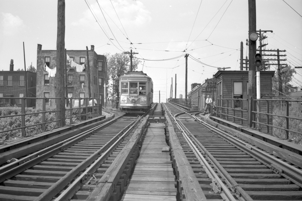 (225k, 1024x684)<br><b>Country:</b> United States<br><b>City:</b> Jersey City, NJ<br><b>System:</b> Public Service of NJ/Public Service Coordinated Transport (NJ) <br><b>Line:</b> Hoboken-Jersey City Elevated<br><b>Location:</b> West of Palisade Ave Station-nr. New York Ave <br><b>Car:</b>  2746 <br><b>Collection of:</b> David Pirmann<br><b>Notes:</b> View west from the trestle, ramps to Palisade Ave street tracks visible.<br><b>Viewed (this week/total):</b> 0 / 803
