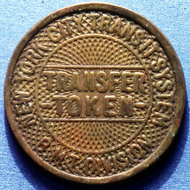 (137k, 615x616)<br><b>Country:</b> United States<br><b>City:</b> New York<br><b>System:</b> New York City Transit<br><b>Collection of:</b> George Cuhaj<br><b>Notes:</b> BMT Division transfer token, brass design, 1940; Obverse<br><b>Viewed (this week/total):</b> 0 / 6157