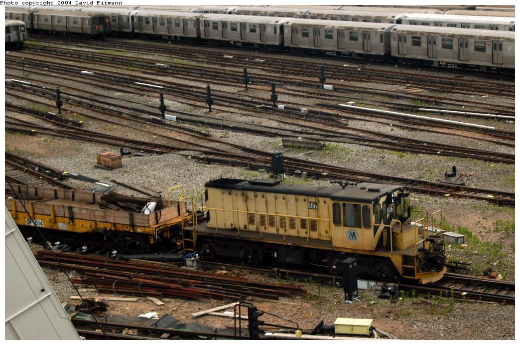 (192k, 1044x692)<br><b>Country:</b> United States<br><b>City:</b> New York<br><b>System:</b> New York City Transit<br><b>Location:</b> Coney Island Yard<br><b>Car:</b> R-77 Locomotive  886 <br><b>Photo by:</b> David Pirmann<br><b>Date:</b> 6/13/2004<br><b>Viewed (this week/total):</b> 0 / 3305
