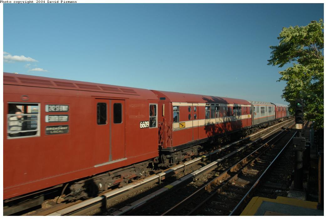 (135k, 1044x701)<br><b>Country:</b> United States<br><b>City:</b> New York<br><b>System:</b> New York City Transit<br><b>Line:</b> IND Rockaway<br><b>Location:</b> Broad Channel <br><b>Route:</b> Fan Trip<br><b>Car:</b> R-15 (American Car & Foundry, 1950) 6239 <br><b>Photo by:</b> David Pirmann<br><b>Date:</b> 6/19/2004<br><b>Viewed (this week/total):</b> 0 / 2233