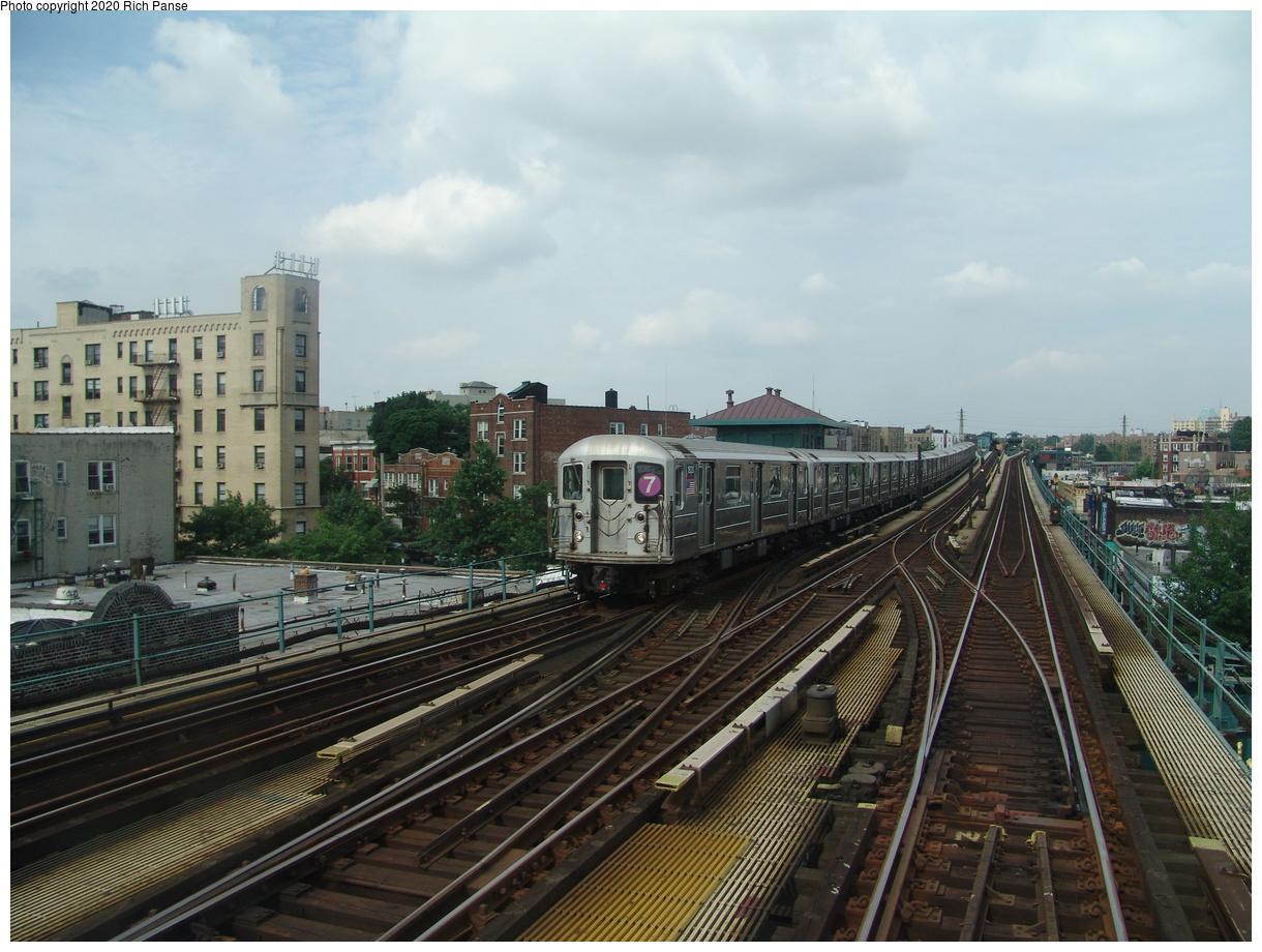 (93k, 820x620)<br><b>Country:</b> United States<br><b>City:</b> New York<br><b>System:</b> New York City Transit<br><b>Line:</b> IRT Flushing Line<br><b>Location:</b> 69th Street/Fisk Avenue <br><b>Route:</b> 7<br><b>Car:</b> R-62A (Bombardier, 1984-1987)  1820 <br><b>Photo by:</b> Richard Panse<br><b>Date:</b> 6/19/2004<br><b>Viewed (this week/total):</b> 1 / 3281