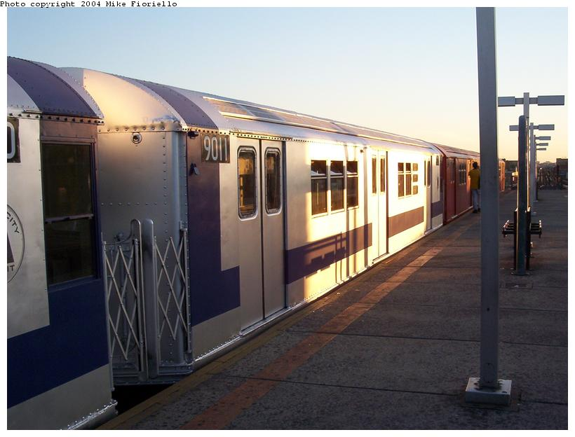 (68k, 820x624)<br><b>Country:</b> United States<br><b>City:</b> New York<br><b>System:</b> New York City Transit<br><b>Line:</b> IRT Flushing Line<br><b>Location:</b> Junction Boulevard <br><b>Route:</b> Fan Trip<br><b>Car:</b> R-33 Main Line (St. Louis, 1962-63) 9011 <br><b>Photo by:</b> Mike Fioriello<br><b>Date:</b> 6/19/2004<br><b>Viewed (this week/total):</b> 4 / 4026