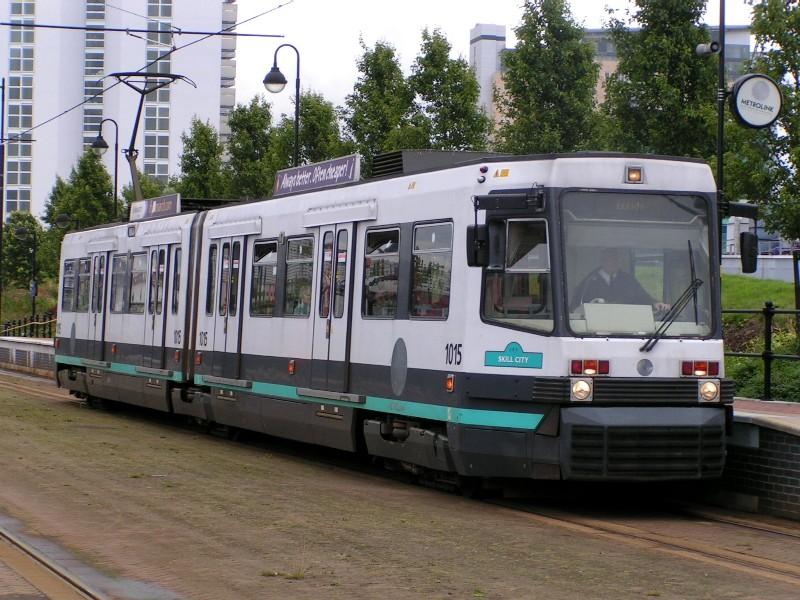 (156k, 800x600)<br><b>Country:</b> United Kingdom<br><b>City:</b> Manchester<br><b>System:</b> Metrolink <br><b>Line:</b> Eccles line<br><b>Location:</b> Broadway <br><b>Car:</b> Manchester T68 (Ansaldo-Breda, 1992)  1015 <br><b>Photo by:</b> Tim Deakin<br><b>Date:</b> 7/10/2004<br><b>Notes:</b> Modified series 1 car 1015 at Broadway<br><b>Viewed (this week/total):</b> 1 / 2106