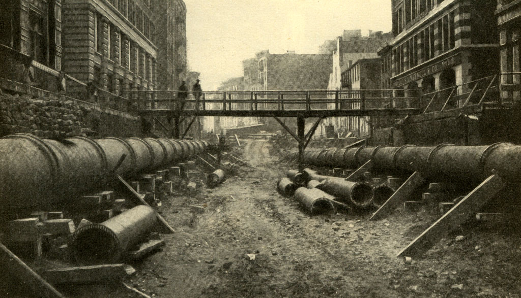 (218k, 1024x587)<br><b>Country:</b> United States<br><b>City:</b> New York<br><b>System:</b> New York City Transit<br><b>Photo by:</b> Munsey's Magazine, 1902 <br><b>Notes:</b> Preliminary work for the tunnel on Elm Street, one of the many points at which great care was necessary in excavating along the Croton water pipes.<br><b>Viewed (this week/total):</b> 0 / 4695