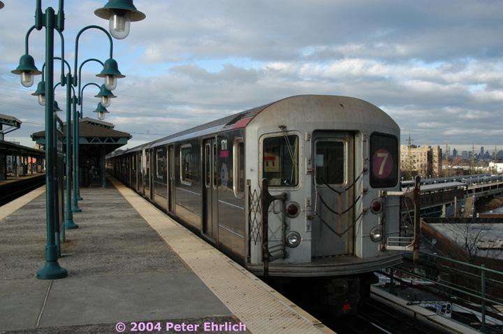 (137k, 720x478)<br><b>Country:</b> United States<br><b>City:</b> New York<br><b>System:</b> New York City Transit<br><b>Line:</b> IRT Flushing Line<br><b>Location:</b> 61st Street/Woodside <br><b>Route:</b> 7<br><b>Car:</b> R-62A (Bombardier, 1984-1987)  1711 <br><b>Photo by:</b> Peter Ehrlich<br><b>Date:</b> 12/25/2003<br><b>Viewed (this week/total):</b> 0 / 2750