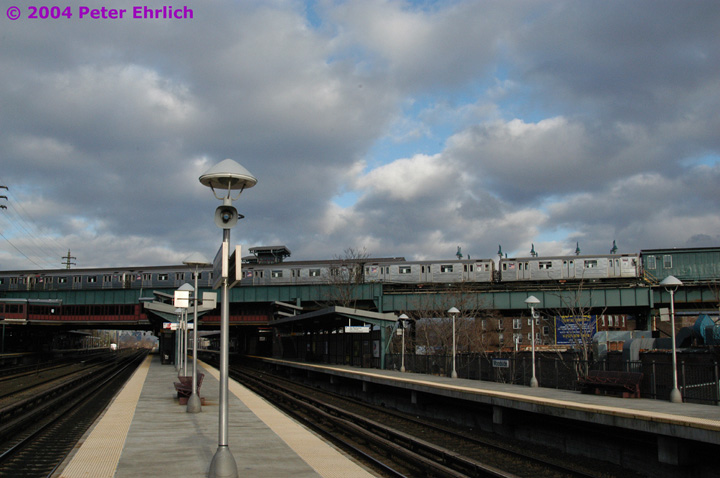 (119k, 720x478)<br><b>Country:</b> United States<br><b>City:</b> New York<br><b>System:</b> New York City Transit<br><b>Line:</b> IRT Flushing Line<br><b>Location:</b> 61st Street/Woodside <br><b>Route:</b> 7<br><b>Car:</b> R-62A (Bombardier, 1984-1987)  1795 <br><b>Photo by:</b> Peter Ehrlich<br><b>Date:</b> 12/25/2003<br><b>Notes:</b> View from the Long Island Rail Road platform.<br><b>Viewed (this week/total):</b> 0 / 3715