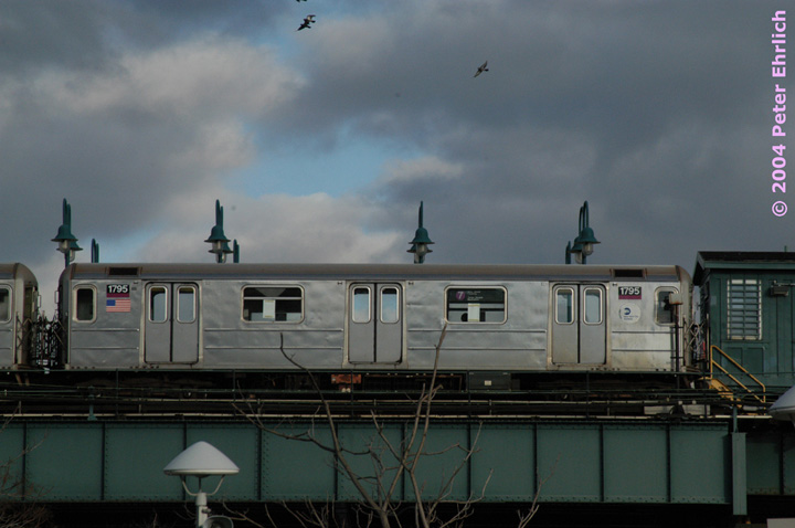 (102k, 720x478)<br><b>Country:</b> United States<br><b>City:</b> New York<br><b>System:</b> New York City Transit<br><b>Line:</b> IRT Flushing Line<br><b>Location:</b> 61st Street/Woodside <br><b>Route:</b> 7<br><b>Car:</b> R-62A (Bombardier, 1984-1987)  1795 <br><b>Photo by:</b> Peter Ehrlich<br><b>Date:</b> 12/25/2003<br><b>Notes:</b> View from the Long Island Rail Road platform.<br><b>Viewed (this week/total):</b> 4 / 3386