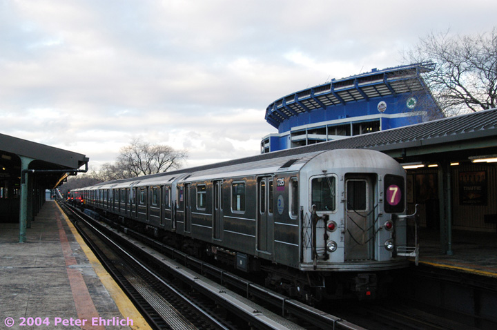 (133k, 720x478)<br><b>Country:</b> United States<br><b>City:</b> New York<br><b>System:</b> New York City Transit<br><b>Line:</b> IRT Flushing Line<br><b>Location:</b> Willets Point/Mets (fmr. Shea Stadium) <br><b>Route:</b> 7<br><b>Car:</b> R-62A (Bombardier, 1984-1987)  1795 <br><b>Photo by:</b> Peter Ehrlich<br><b>Date:</b> 12/25/2003<br><b>Viewed (this week/total):</b> 1 / 3177