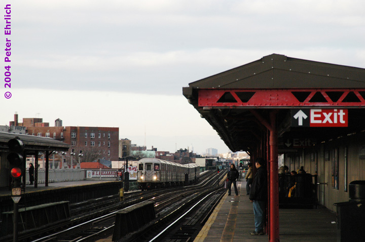 (113k, 720x478)<br><b>Country:</b> United States<br><b>City:</b> New York<br><b>System:</b> New York City Transit<br><b>Line:</b> IRT Flushing Line<br><b>Location:</b> 90th Street/Elmhurst Avenue <br><b>Route:</b> 7<br><b>Car:</b> R-62A (Bombardier, 1984-1987)  1826 <br><b>Photo by:</b> Peter Ehrlich<br><b>Date:</b> 12/25/2003<br><b>Viewed (this week/total):</b> 1 / 3898