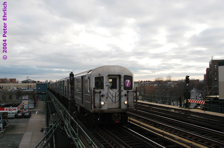 (115k, 720x478)<br><b>Country:</b> United States<br><b>City:</b> New York<br><b>System:</b> New York City Transit<br><b>Line:</b> IRT Flushing Line<br><b>Location:</b> 90th Street/Elmhurst Avenue <br><b>Route:</b> 7<br><b>Car:</b> R-62A (Bombardier, 1984-1987)  2030 <br><b>Photo by:</b> Peter Ehrlich<br><b>Date:</b> 12/25/2003<br><b>Viewed (this week/total):</b> 1 / 2892