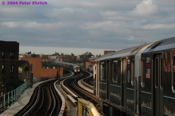 (123k, 720x478)<br><b>Country:</b> United States<br><b>City:</b> New York<br><b>System:</b> New York City Transit<br><b>Line:</b> IRT Flushing Line<br><b>Location:</b> 61st Street/Woodside <br><b>Route:</b> 7<br><b>Car:</b> R-62A (Bombardier, 1984-1987)  2035 <br><b>Photo by:</b> Peter Ehrlich<br><b>Date:</b> 12/25/2003<br><b>Notes:</b> Rare Christmas Day operation on the express track, made necessary due to a problem further inbound between 61st Street and Queensboro Plaza.<br><b>Viewed (this week/total):</b> 0 / 3888